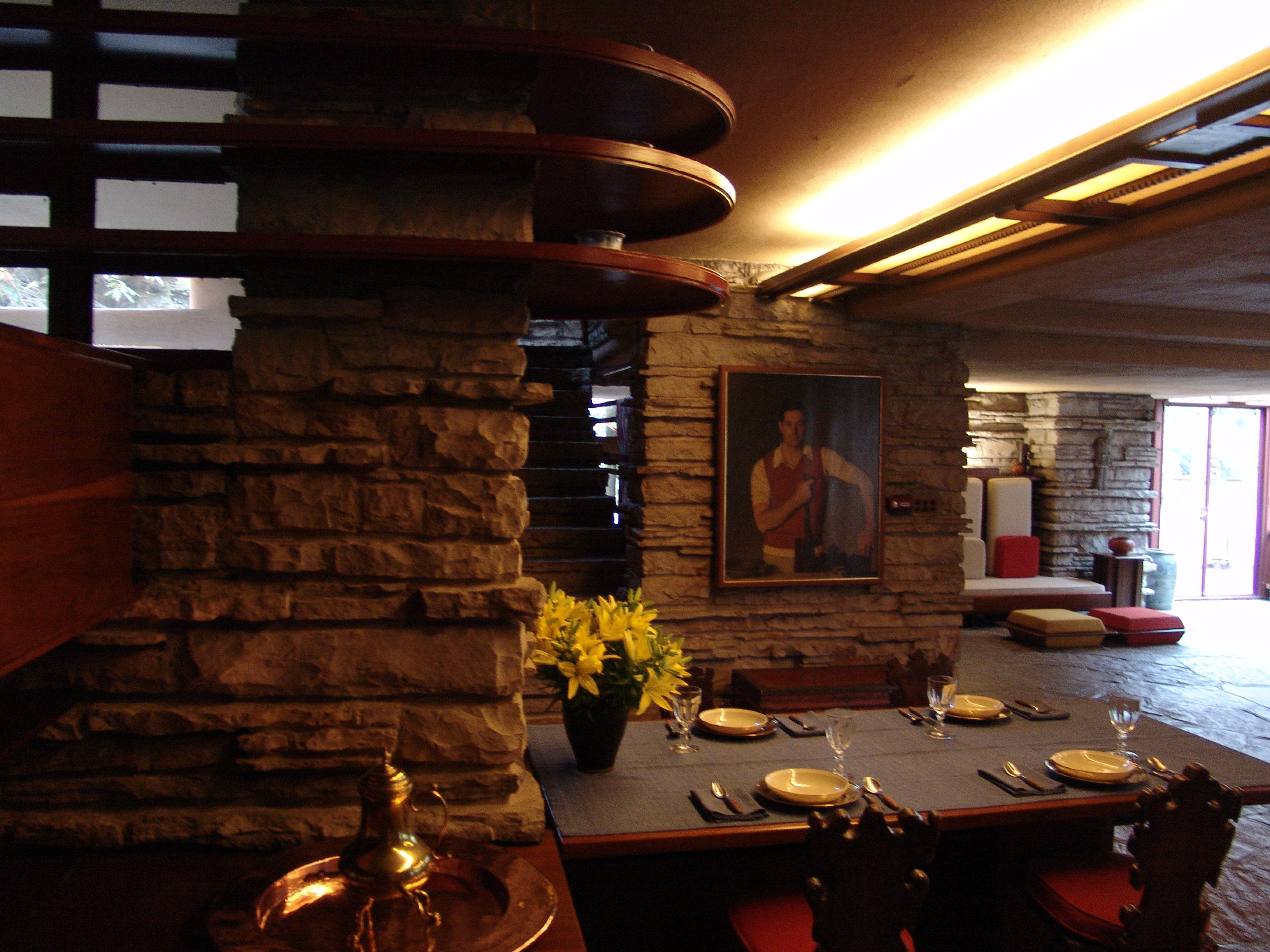 Fallingwater dining area with kaufmann portrait frank for Dining area interior