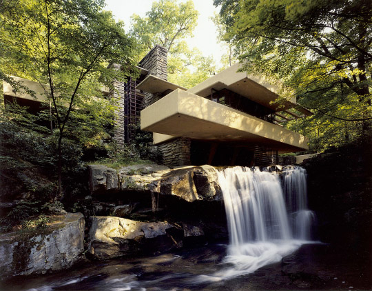 [Fallingwater main house from low angle near waterfall]