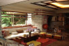 [Picture of Fallingwater living room: sitting area and fireplace]